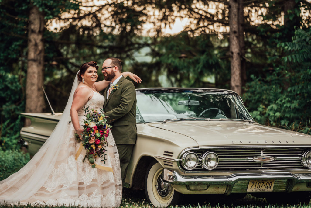 Rachel and Andrew at the drive-in for their wedding with a 1960 Chevy Impala.