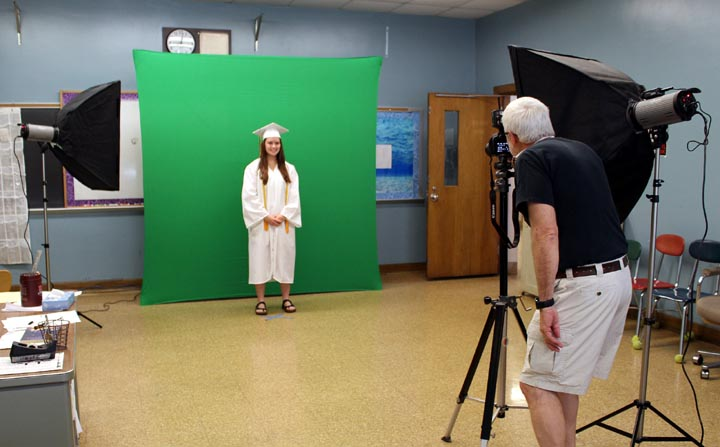 Class of 2020 graduate gets photographed by McMorris,to be added to group photo later on.