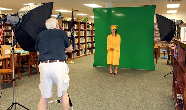 Thomas McMorris photographs a graduating student