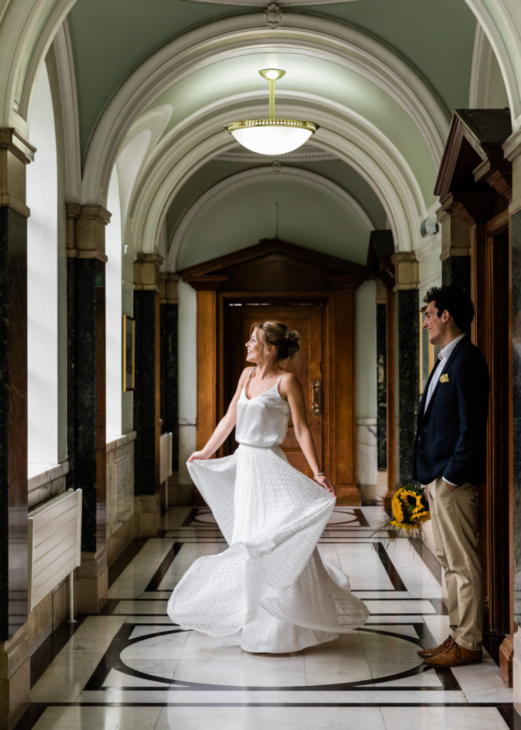 bride twirls in dress for interesting wedding photos with movement