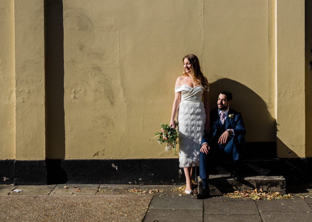 using colors of city walls to create cool wedding photos