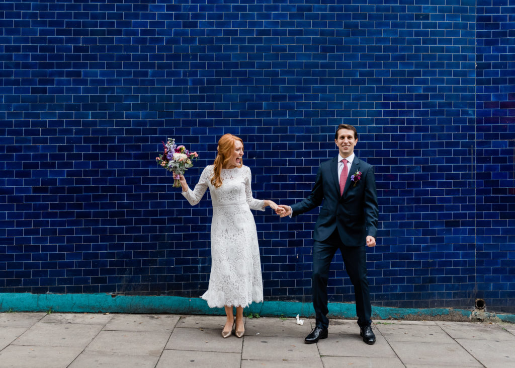 bold wall colors photographing in city with wedding couples