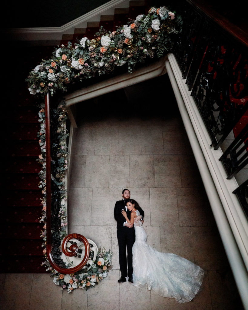 Playful photo concept of bride and groom on floor.