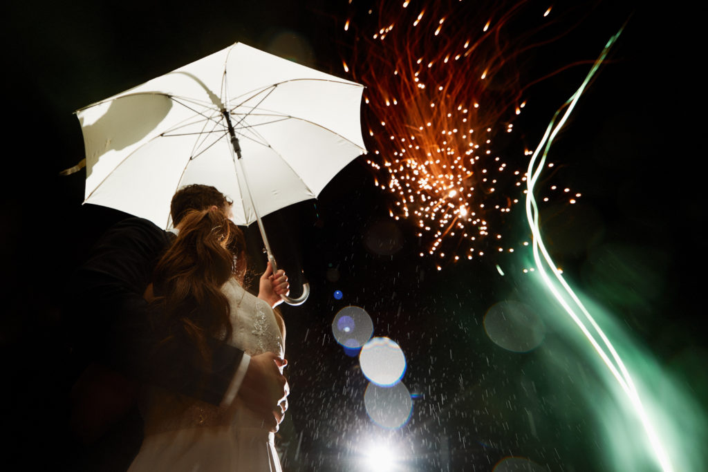 bride and groom wrap up day with fireworks for a timeless wedding portrait.