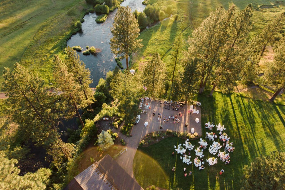 A drone point of view of a wedding reception.