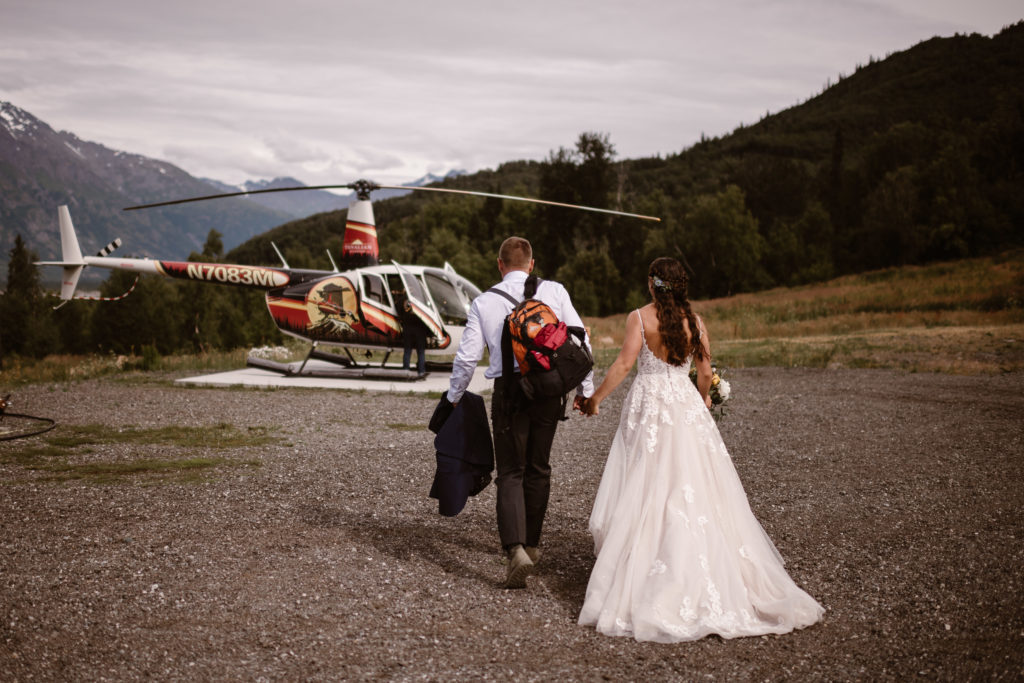 planning for all-day elopement package, couple heads to helicopter with maddie mae of adventure instead