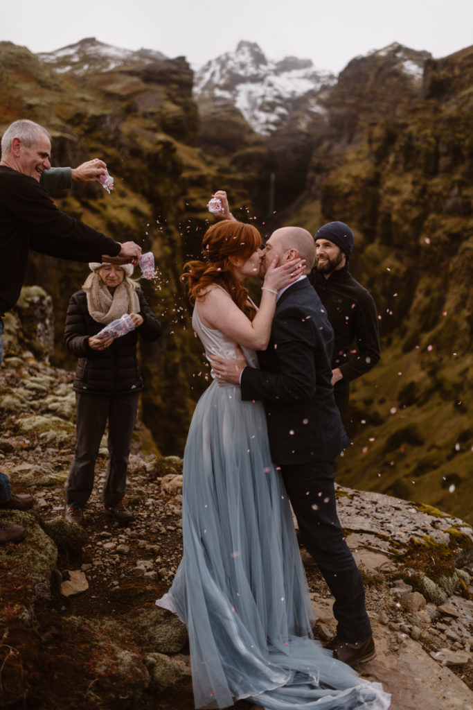couple kisses at their ceremony during all-day elopement by adventure instead